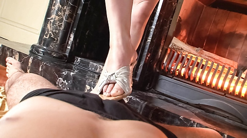 Kinky babe jerking a hard cock and giving it a foot rub